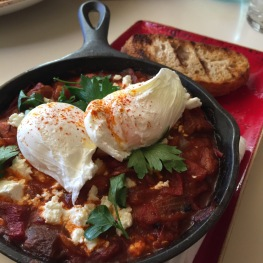 Shakshuka: poached eggs / roasted tomatoes / cranberry beans / roasted sweet peppers / feta cheese / toast...$18 -- Eggs poached to perfection looking like hot hair balloons. Dish is mildly spicy, toast is a little crunchy like a crostini. Needs to be more of a country bread so it maintains some chew when toasted. Cranberry beans are like pinto beans. All together, good dish minus the toast and could use some sausage so order it as a side to add