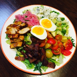 "Cobb Salad - chopped romaine / mizuna / egg / avocado / cherry tomato / bacon / Pt. Reyes blue - $15... add grilled chicken $5 - This is it. The new gold standard for cobb salads. Big enough to share but you won't want to. The best one I've ever had, no joke. If you enjoy cobb salads, order it and see what I mean. The bacon is amazing. It's thick cut, crispy, but not overcooked. They got me hooked on the grilled chicken last salad and it's a great add on to the cobb. The tomatoes are plump and lightly seasoned with salt and pepper. The egg on top is hard boiled to perfection, in my opinion, where the egg is a runny, custard consistency. The blue cheese on this has changed my opinion of blue cheese. I now have to say I'm not a big fan of ""cheap"" blue cheese. Because Pt. Reyes' award winning blue cheese made with raw cow's milk tastes great. It does have a strong blue cheese flavor but it's also sweet and creamy and pairs well with the other ingredients"