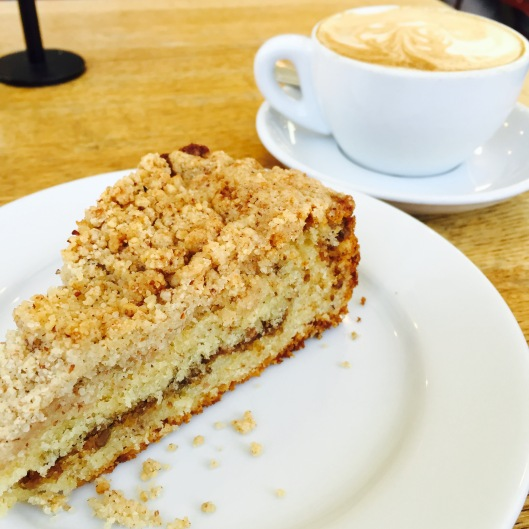 """Coffee Cake - It makes no sense to me what this is called coffee cake. It doesn't taste like coffee and it has no frosting to make it a cake. It must get the name because someone starting eating it in morning with their coffee. I guess it pairs well with coffee since the bread is sweet and a little dry so the coffee helps balance the sweetness and wash it down. But what do I know. Huckleberry makes there coffee cake with butter, all purpose flour, almond meal and sugar. The best part of the cake is the streusel which is made of toasted walnuts, sugar and cinnamon. Streusel [STROO-zuhl] is German for """"sprinkle"""" or """"strew"""" and is the name given to the crumbly topping on coffeecakes and other baked goods"""