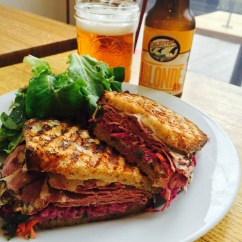 """Niman Ranch Pastrami Reuben - Russian dressing / coleslaw / Gruyere cheese / dijon mustard / country bread / Eel River California Blonde Ale - $14.5 - Hate to say it Katz's Deli in New York but this is the best Reuben I've ever had. Ok, I'll say this is the best """"gourmet"""" reuben since Katz stays true to the classic preparation of corned beef, swiss cheese, sauerkraut and rye bread. Huckleberry puts a twist on it that really pays off. An amazing coleslaw concoction that they make and sell separately during the week is topped on the pastrami and sandwiched between two perfectly grilled pieces of bread. The pressing and grilling melts the cheese and presses the Russian dressing and mustard into the meat and slaw. Crunchy/soft grilled bread, juicy/tender meat, melted cheese, fresh coleslaw, I was legitimately depressed when this thing was gone. I wanted another one. Well done Huckleberry, well done.The name coleslaw comes from the Dutch word koolsla meaning """"cabbage salad""""Russian dressing, although American in origin, is thought to get its name from the fact that earlier versions of the dressing contained caviar which the Russians are famous for. American version includes mayo, pimiento, chili sauce or ketchup, chives and herbs.The Reuben has two rumored origins. Thought to be created by Arthur Reuben, owner of once famous New York's Reuben's deli. Other story is that Reuben Kay, an Omaha wholesale grocer,invented it during a 1955 poker game. The following year the sandwich was then entered in a national sandwich contest and won."""