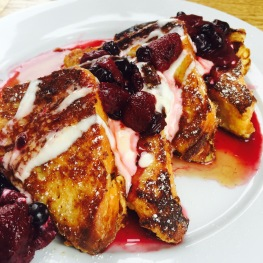 Brunch Special: Milo & Olive Brioche French Toast - berry compote / crème fraîche / maple syrup - $13.5 - Milo & Olive is one of Huckleberry's sister restaurants and they make a great french toast. Brioche [BREE-ohsh] is always an excellent bread to use since its rich in butter and eggs making it slightly sweet and very fluffy. The thickness allows it to really soak up the flavors from the berry compote and crème fraîche.They give you a small dish of maple syrup which is appropriate since hardly any is needed. The berry compote and crème fraîche slowly melt together and create their own sweet syrup. Compote [KAHM-poht] is a chilled dish of fresh or dried fruit that is slowly cooked in a sugar syrup. The slow cooking allows the fruit to keep its shape. Crème Fraîche [krehm FRESH] is a matured, thickened cream with a slightly tangy, nutty flavor. The thickness coming from being made with unpasteurized cow's milk where the bacteria in the milk thickens it naturally over the course of 8-24 hours