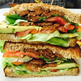 "Andy's Favorite ""TLT"": Tempeh / Lettuce / Tomato / Avocado / Vegenaise & Whole Grain Bread...$12 - Woah. This Vegan BLT shocked me at how good it was. I'm typically not a fan of Tempeh but they got the seasoning and texture of this to closely resemble thick cut bacon. The whole grain bread being toasted really gave it the crunchiness it needed from the lack of bacon being crispy. The vegan mayo tasted exactly like mayonnaise. It's also a sizable sandwich given the number of ingredients used. The cheapest sandwich on the menu and one of my favorites. Not a bad deal"