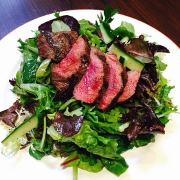 Leafy Greens Salad - Oak leaf lettuces / snap peas / sherry mustard vinaigrette - $8 half / $12 full... add seared sirloin steak $6 - You can add chicken or steak to any of their salads. I thought this would be a good salad to add the steak to because it is pretty simple. This is the full order. Not a fan of half orders of salads. The steak on here was great. I'm usually not a fan of seared steak since the middle tends to be medium rare but given the quality of meat Belcampo uses I knew this was the preferred method. You definitely don't want to overcook really good meat. The steak, despite being undercooked, was tender enough to cut with my butter knife which was impressive. The outside was perfectly seared and nicely salted to bring out the full flavor of the high quality meat. Salad is nice and light and with the hint of mustard flavor in the dressing, acts as a great companion to the steak